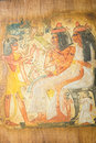 Egyptian family ancient hand painting on papyrus Royalty Free Stock Photo