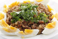 Egyptian foul with boiled eggs or ful medames on a plate garneshed slices of hard egg and flat leaf parsley foulm made from fava Royalty Free Stock Image