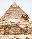 Egyptian Great Sphinx full body portrait head,with pyramids of Giza background Egypt empty with nobody. copy space Royalty Free Stock Photo