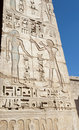 Egyptian hieroglyphic carvings on a temple wall Stock Photos