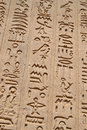 Egyptian hieroglyphic carvings on a wall Royalty Free Stock Photography