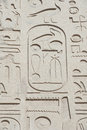 Egyptian hieroglyphic carvings on wall Stock Image