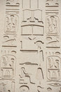 Egyptian hieroglyphic carvings on wall Royalty Free Stock Photos