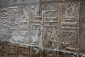 Egyptian hieroglyphics on stone relief close up Royalty Free Stock Photos