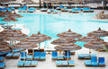 Egyptian hotel resort background swimming pool cane umbrella Royalty Free Stock Image