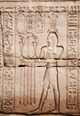 Egyptian images and hieroglyphs engraved on stone Stock Image