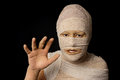 Egyptian mummy woman wrapped up with bandages as an as halloween costume Stock Images