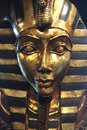 Egyptian pharaoh face an and statue in gold Stock Images