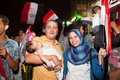 Egyptian revolution family with month baby sharing in the that brought down the muslim brotherhood Stock Photo