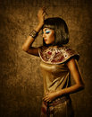 Egyptian style woman bronze cleopatra portrait beautiful over golden background Stock Image