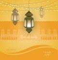 Eid al adha. Greeting card template on Eid Al-Fitr muslim religious holiday with lanterns on blurred lights background