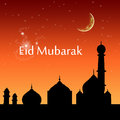 Eid evening sky greeting illustration with an scene silhouette of a mosque on a red Stock Images