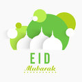 Eid Mubarak celebration with paper cutout mosque. Royalty Free Stock Photo