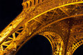 Eiffel tower arch base at night paris june illuminated on june as a top business and cultural center paris is one of the most Royalty Free Stock Photo