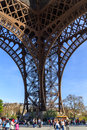 Eiffel tower base east pillar pilier est of the in paris with tourists around it Stock Image