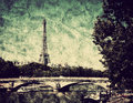 Eiffel Tower and bridge on Seine river in Paris, France. Vintage Royalty Free Stock Photo