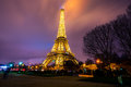Eiffel Tower brightly illuminated at dusk Royalty Free Stock Photo