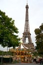 Eiffel tower and carousel behind a in paris france Royalty Free Stock Photography