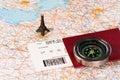 Eiffel tower, compass and passport