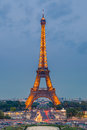 Eiffel tower at dusk paris april brightly illuminated on april in paris the is the most visited monument of france Royalty Free Stock Photography