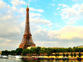 Eiffel tower at dusk seine river a view of the with the in the foreground Royalty Free Stock Photography