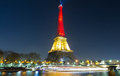 The Eiffel tower lit up with the colors of Belgian National flag Royalty Free Stock Photo