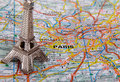 Eiffel tower on a map of paris short focus Royalty Free Stock Photo