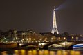 Eiffel tower with night illumination and pont des invalides paris april on april in paris france the is the most Stock Image