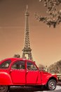 Eiffel Tower with old red car in Paris, France Royalty Free Stock Photo