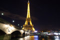 Eiffel tower over seine in paris night scene with lights on Royalty Free Stock Photography