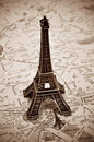 The eiffel tower in paris france a reproduction of on a map of with sepia toning Royalty Free Stock Photos