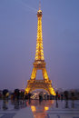 Eiffel tower in Paris with tourists at dusk Royalty Free Stock Photo