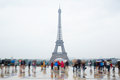 Eiffel tower in Paris with tourists and rain Royalty Free Stock Photo