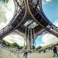 The eiffel tower in paris view from below tourists visiting on september is one of major tourist attractions of france Stock Photography