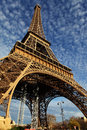 Eiffel Tower in Paris on the winter with the white clouds Royalty Free Stock Image