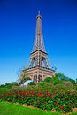 Eiffel tower red roses in paris france and park with at a sunny summer day Stock Images