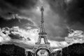Eiffel Tower seen from Champ de Mars park in Paris, France. Black and white Royalty Free Stock Photo