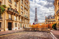 Eiffel Tower seen from the street in Paris, France.  Cobblestone pavement Royalty Free Stock Photo