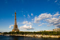 Eiffel Tower beside the Seine river Royalty Free Stock Photography