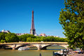 Eiffel tower and seine river paris france bridge on in view from alexandre bridge at sunny day Stock Photography