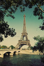 Eiffel Tower and Seine river in Paris, France. Vintage Royalty Free Stock Photo