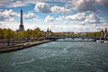 Eiffel Tower, the Seine river under Alexandre III bridge Stock Photos
