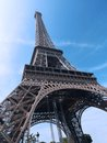 Eiffel tower shot upwards against blue sky Royalty Free Stock Image