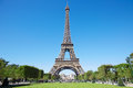 Eiffel tower sunny summer day with blue sky and green grass field of mars in paris Royalty Free Stock Image