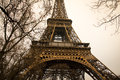 Eiffel tower with trees the from below Stock Photo