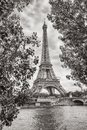 Eiffel Tower view on Seine river in Paris, France. Black and white colored