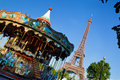 Eiffel tower and vintage carousel paris france at a sunny summer day Royalty Free Stock Photography