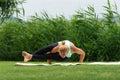 Eight angle pose Astavakrasana Yoga Royalty Free Stock Photo