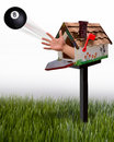 Eight ball out of maibox an tossed a mailbox Royalty Free Stock Images