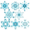 Eight blue snowflakes Stock Photos
